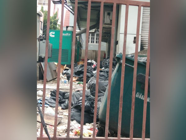Waste material seen dumped behind the fast-food outlet in Mehdipatnam. Photo/ANI