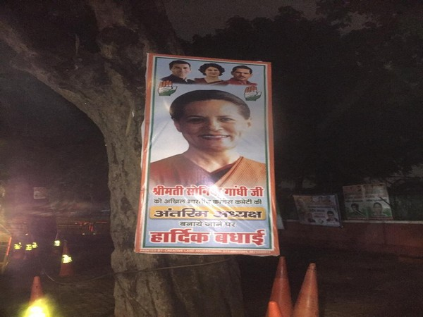 Poster outside the Congress headquarter in the national capital. Photo/ANI