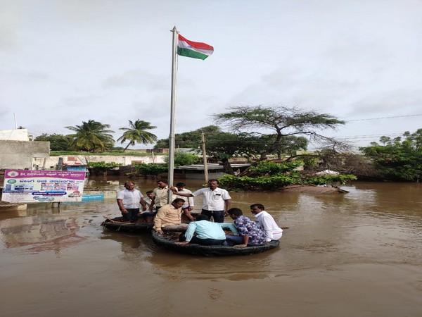 Shurpali villagers hoist national flag in floodwater in Karnataka