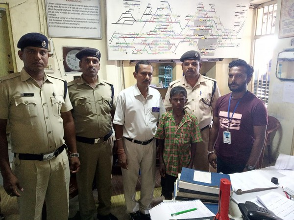 Police officials and RPF with a minor they rescued from a train in Odisha (Photo/ANI)
