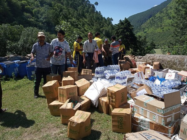 Relief workers with bottled water in Uttarakashi on Friday.