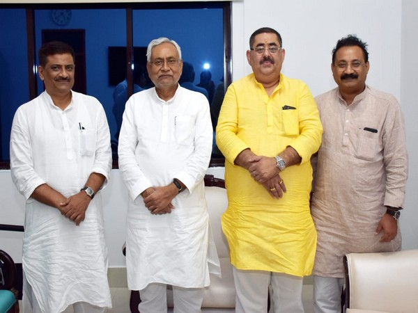 Bihar Chief Minister Nitish Kumar with party's Delhi president Dayanand Rai on Monday. Photo/ANI