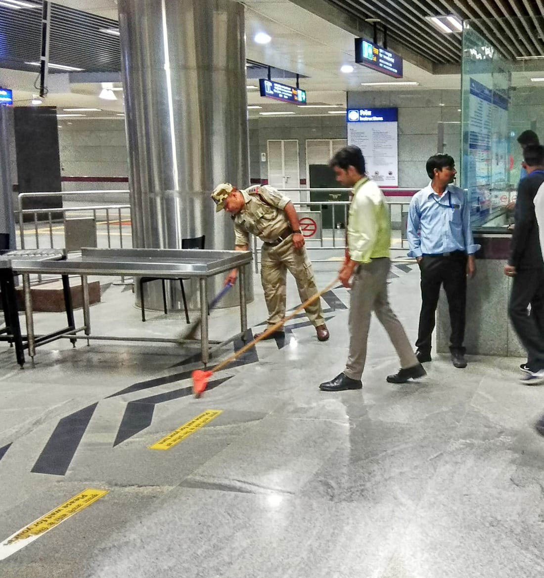 DMRC and CISF staff cleaning a metro station in New Delhi on Wednesday. Photo/ANI