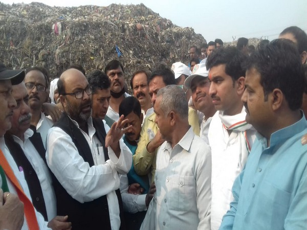 Uttar Pradesh Congress Committee President Ajay Kumar Lallu in the Kanpur Municipal Corporation dumping yard on Thursday. photo/ANI