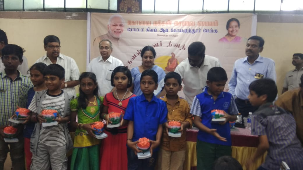 'Hundies' were distributed among students during the celebrations of Thiruvalluvar Day in Coimbatore on Thursday.