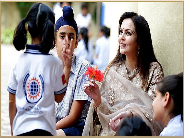 Founder of Dhirubhai Ambani International School Nita Ambani with school children.
