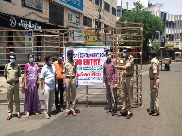 Police personnel at a COVID-19 containment zone in Khairtabad, Telangana on Thursday