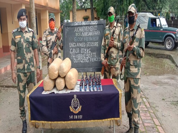 BSF jawans of the 141st Battalion pose with the confiscated items. (Photo/ANI)