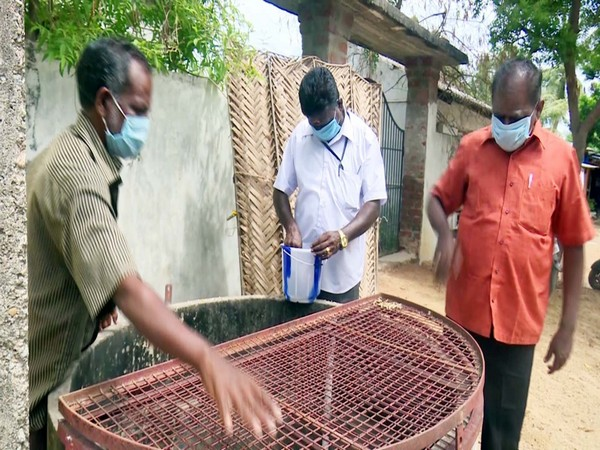Health workers in Rameswaram releasing Gambusia fish in a well. (Photo/ANI)