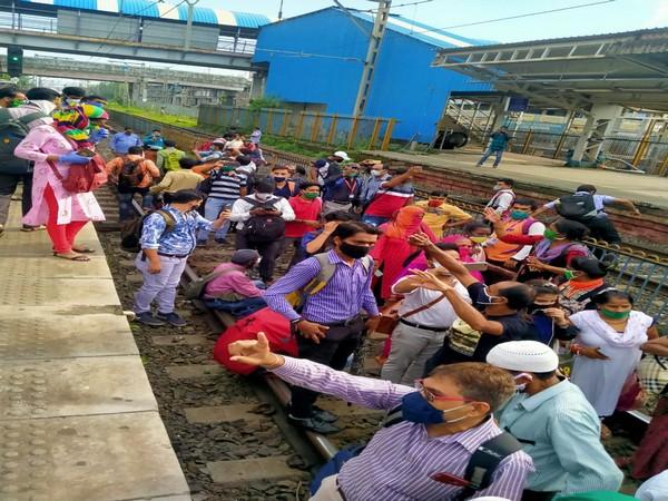 Protesters on railway tracks at Nalasopara Railway Station (Photo/ANI)