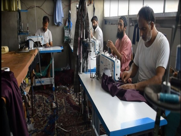 Workers stitching in a factory in Pulwama, J-K. [Photo/ANI]