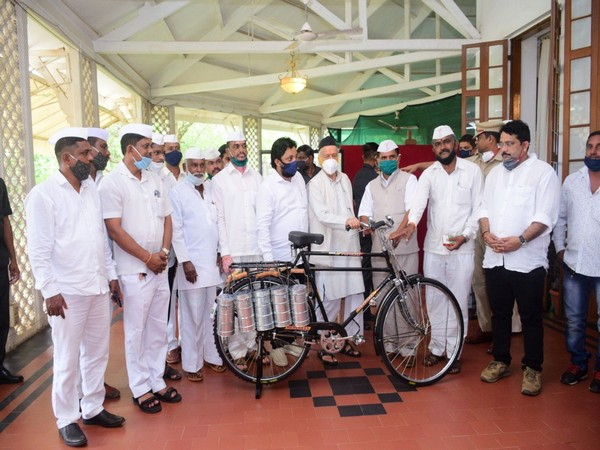 Maharashtra Governor Bhagat Singh Koshyari with several dabbawalas at Raj Bhavan on Monday.