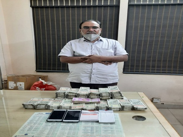 A man held for illegal hawala transaction. (Photo/ANI)
