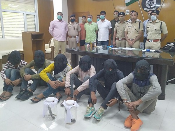 Haryana Police with arrested criminals (Photo/ANI)