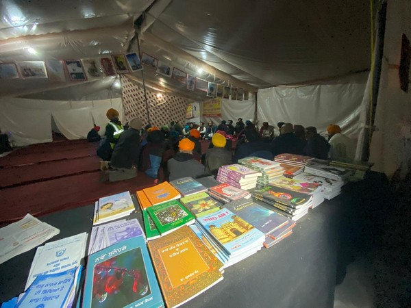 Makeshift library cum cultural centre Sanjhi Sath set up at Singhu border. (Photo/ANI)