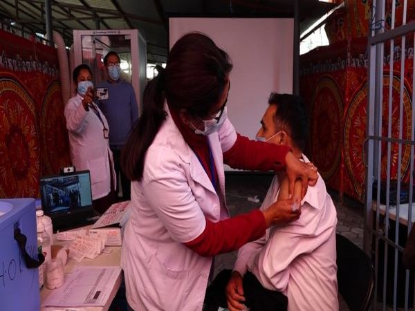 Frontline workers reciving a dose of the Covishield vaccine in Kathmandu (Photo/ANI)