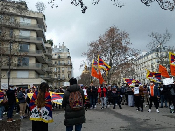Demonstrators carrying Tibetans flags and placards raised slogans against the Chinese government.