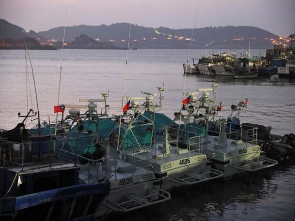 Taiwanese flags flutter on coast guard boats at a port on Nangan island,