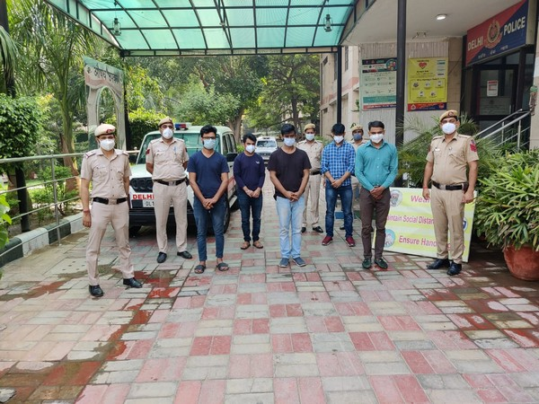 Malviya Nagar police with the five arrested people (Photo/ANI)