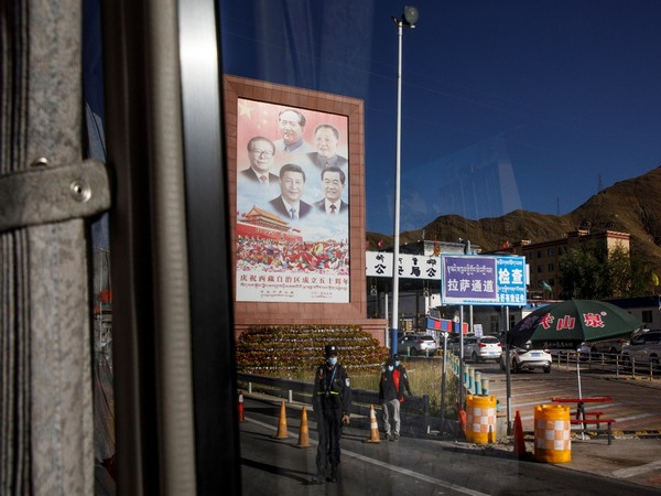 Portraits of Chinese President Xi Jinping and former leaders Jiang Zemin, Mao Zedong, Deng Xiaoping and Hun Jintao at a checkpoint in Lhasa, Tibet