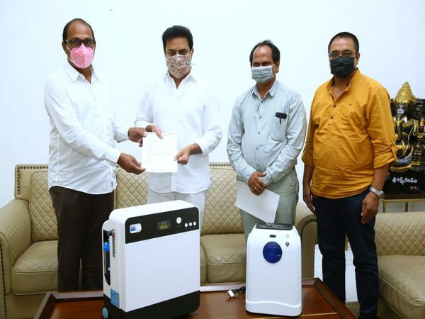 TIF donating oxygen concentrators to Minister of Municipal Administration and Urban Development K T Rama Rao (Photo/ANI)