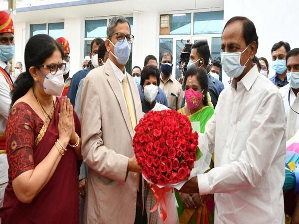 CJI Ramana being recieved by Telangana Governor Tamilisai Soundararajan and Chief Minister K Chandrashekhar Rao at Bhavan on Friday.