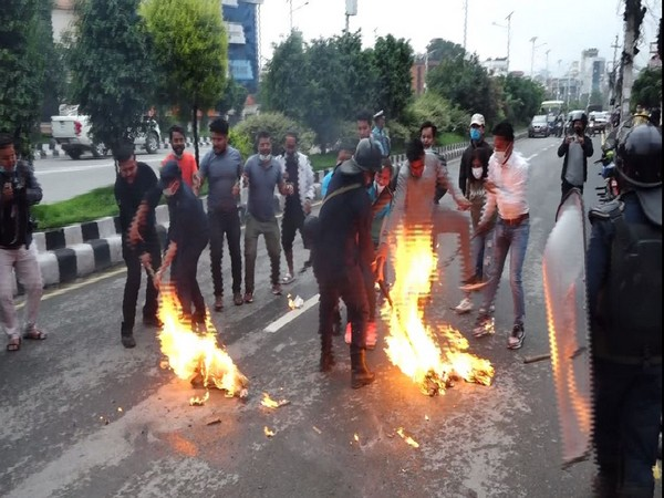 Opposition alliance student union burn effigy of Nepal parliament.