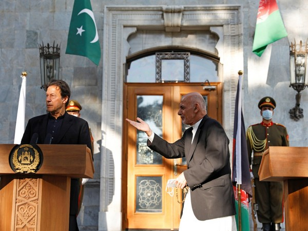 Afghan President Ashraf Ghani leaves after a joint news conference with Pakistan's Prime Minister Imran Khan at the presidential palace in Kabul.