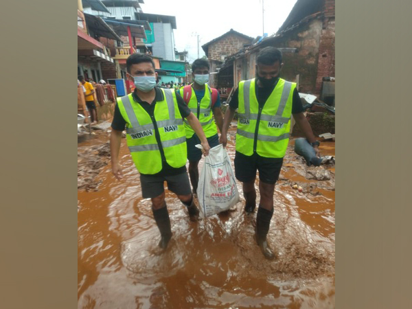 Indian Navy's flood rescue team helping locals to recover from flood