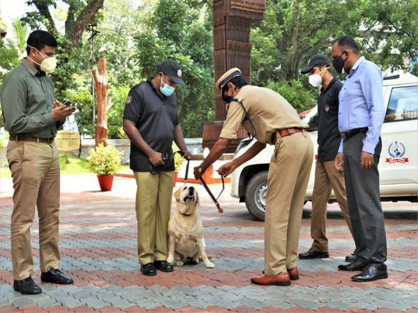 Kerala police confrere commendation medal to tracker dog 'Jarry' (Photo/ANI)