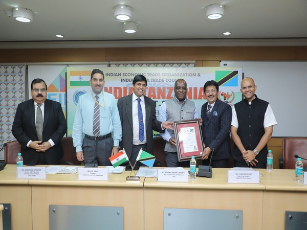 High Commissioner of Tanzania HE Baraka Luanda along with other delegates presenting the Certificate of Appointment to Dr. J. Shrenik Nahar, IATC Trade Commissioner for Tanzania