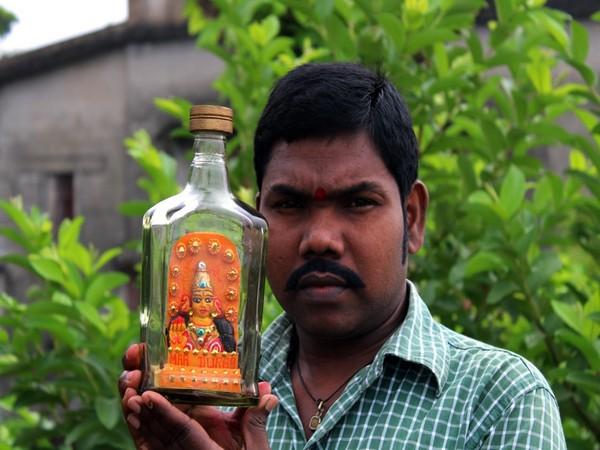 Miniature artist Rao crafts eco-friendly idol of Goddess Durga inside bottle.