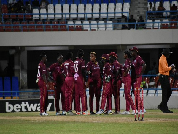 West Indies women gathered in the middle after taking a wicket. (Photo/Windies Cricket Twitter)