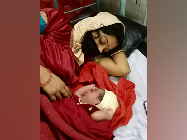 The woman with her child at the Rural Hospital in Igatpuri. (Photo/ANI)