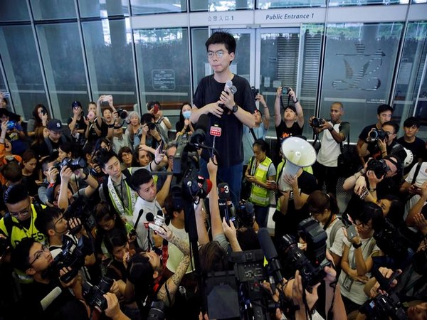 Joshua Wong talks to protesters after being released from jail