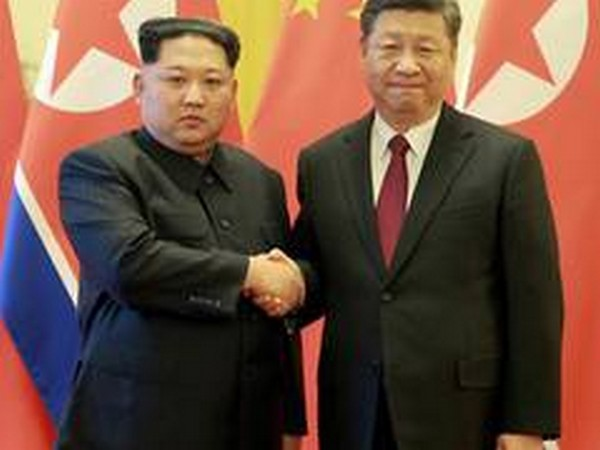 North Korean leader Kim Jong-un with Chinese President Xi Jinping (file photo)