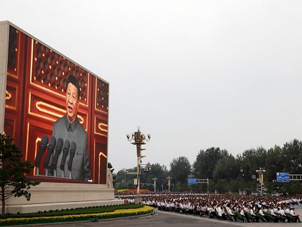 Chinese President Xi Jinping is seen on a giant screen as he delivers a speech at the event marking the 100th founding anniversary of the Communist Party of China. (Photo Credit: Reuters)