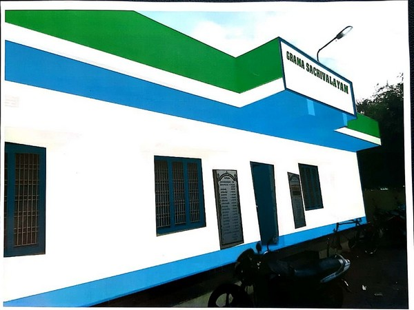 Visual of a village secretariat in Andhra Pradesh painted in YSRCP's flag colour. Photo/ANI