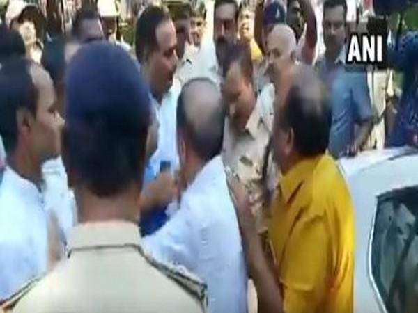 A still from the viral video showing scuffle between police and CM B S Yediyurappa's son-in-law Virupaksha Yamakanamaradi. Photo/ANI