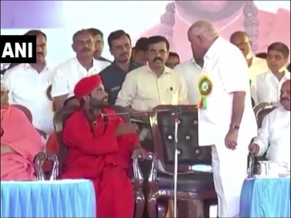 Karnataka Chief Minister BS Yediyurappa with Swami Vachananda at the event in Davanagere on Tuesday. Photo/ANI
