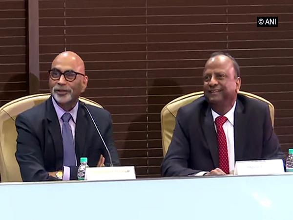 Yes Bank Administrator Prashant Kumar (left) with SBI Chairman Rajnish Kumar in Mumbai on Tuesday.