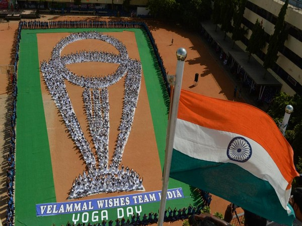 Children performing 'Yoga' in World Cup trophy formation in Chennai