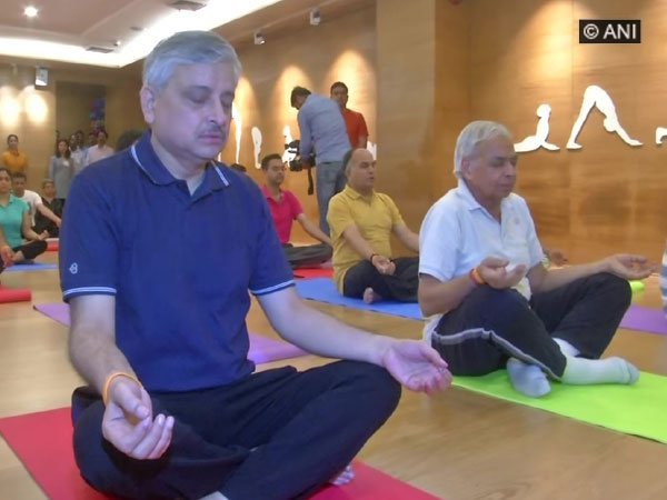 AIIMS Director Dr Randeep Guleria (left) doing yoga