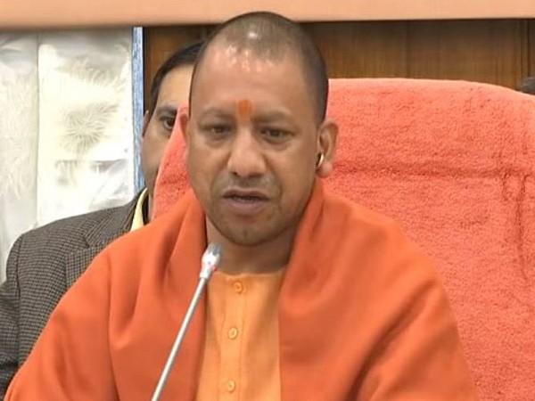 Uttar Pradesh CM Yogi Adityanath while addressing a public rally in  South Dinajpur on a telephone on Sunday. [File Photo/ANI]
