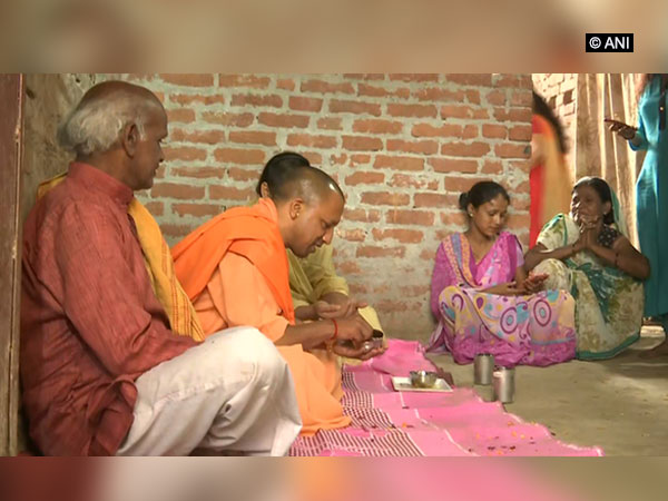 UP Chief Minister Yogi Adithyanath having lunch in Ayodha during his visit to a Dalit Family. Photo: ANI