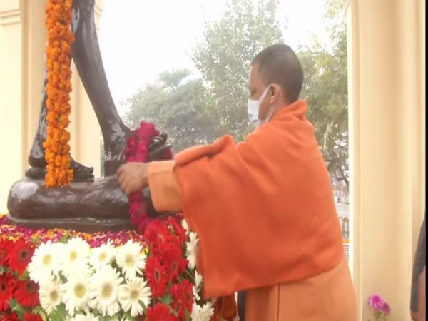 UP CM Yogi Adityanath garlanding the statue of Mahatma Gandhi at Hazratganj