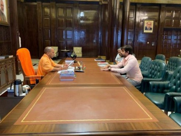 UP Chief Minister Yogi Adityanath meeting DUSU president Shakti Singh in Lucknow on Monday.