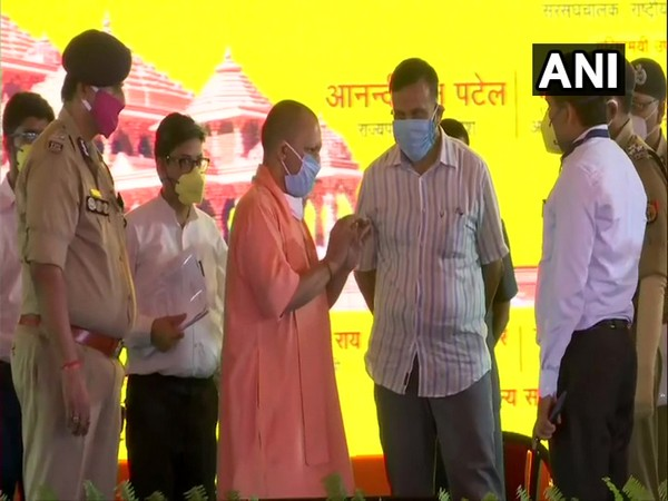 Uttar Pradesh Chief Minister Yogi Adityanath being briefed by officials about preparations for August 5 ceremony. [Photo/ANI]