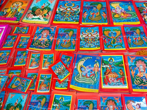 Murals of gods and goddesses on display in a market in Kathmandu