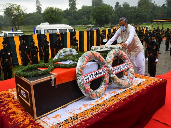 Uttarakhand CM Trivendra Singh Rawat  laid a flower wreath on the mortal remains of a soldier on Tuesday. [Photo/ANI]